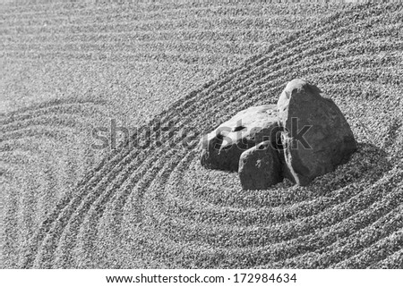 View of the zen garden with raked gravel sand and rocks, traditional Japanese temple settings, black & white photo - stock photo