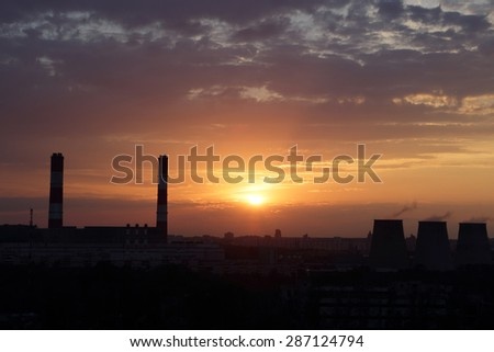 View of thermoelectric power plant at sunset