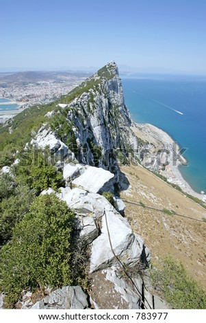 View of tip of Rock of Gibraltar looking out to sea and the Spanish coast beyond - stock photo