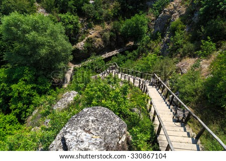 View of Tokatli Canyon in Safranbolu Karabuk, with wooden stairs and green trees around big mountains. - stock photo
