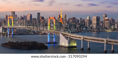 View of Tokyo bay with Tokyo tower and Tokyo rainbow bridge - stock photo