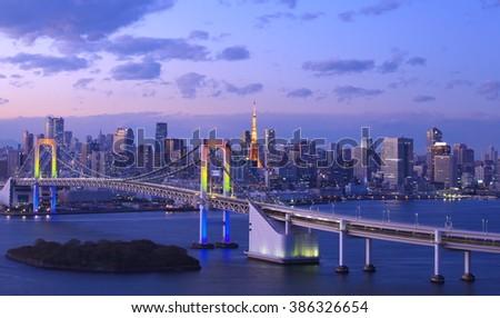 View of Tokyo bay with Tokyo tower and Tokyo rainbow bridge , Tokyo Bay spans the coasts of Tokyo, Kanagawa , and Chiba  - stock photo