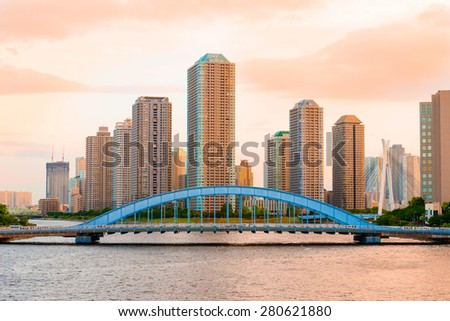 View of Tokyo Highrise Condominium and Sumida River in the Evening - stock photo