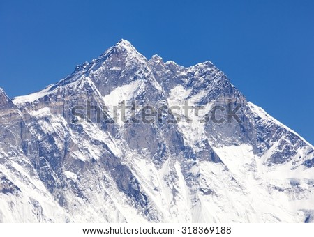View of top of Lhotse, South rock face - Way to Everest base camp, three passes trek, Everest area, Sagarmatha national park, Khumbu valley, Nepal - stock photo