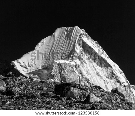 View of top of the peak Langtern (6712 m) from Kala Patthar - Nepal, Himalayas (black and white) - stock photo