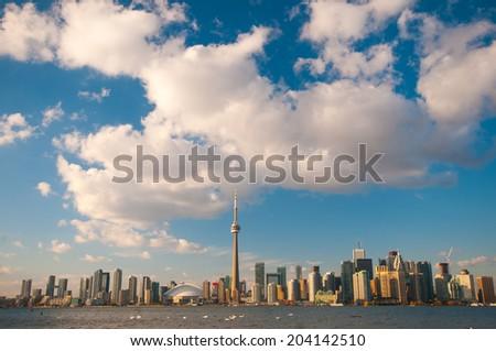 View of Toronto skyline with blue sky over Ontario lake - stock photo