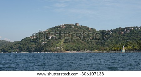View of town on hillside along coastline, Zihuatanejo, Guerrero, Mexico