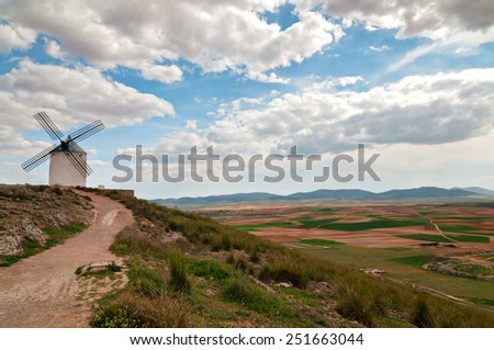 View of traditional windmill in Consuegra, Toledo, Spain - stock photo