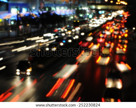 View of Traffic on a Busy Street at Night - Image Has Motion Blur and Soft Focus - stock photo
