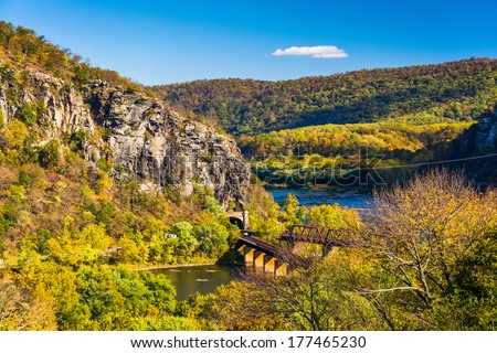 View of train bridges and the Potomac River in Harper's Ferry, West Virginia. - stock photo