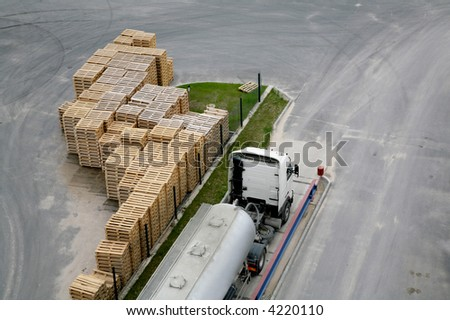 view of truck and wooden crates from top - stock photo