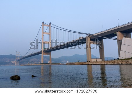 View of Tsing Ma Bridge from Park Island in Hong Kong  - stock photo