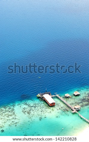 View of Turquoise Ocean and Jetty from the top of an island of borneo, Malaysia - stock photo