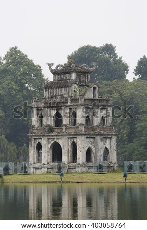 View of Turtle Tower on a small island on Hoan Kiem lake (known as Jade lake). This area is the center of Hanoi capital, Vietnam. - stock photo