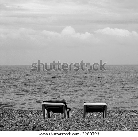 view of two chairs  on the beach - stock photo