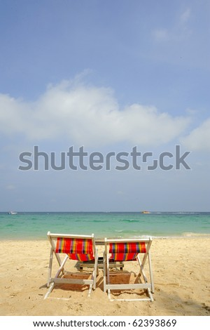 view of two chairs on the beach