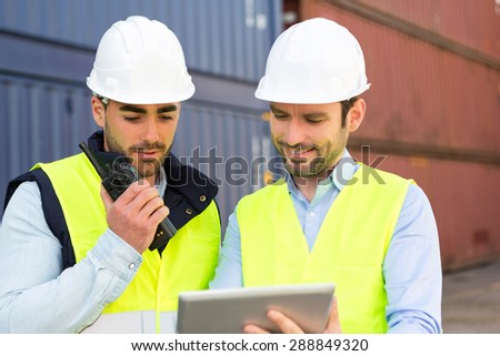 View of Two young attractives dockers working on the dock