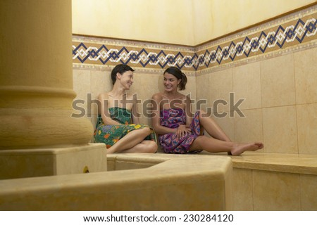 View of two young women relaxing in a sauna - stock photo