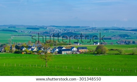 view of typical belgian countryside in ardennes region near bastogne. - stock photo