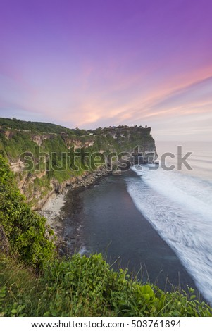 View of Uluwatu temple cliff with pavilion and blue sea in Bali, Indonesia