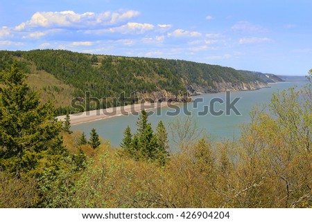 View of unspoilled wilderness with cliffs and Melvin Beach on the Fundy trail in New Brunswick, Canada - stock photo