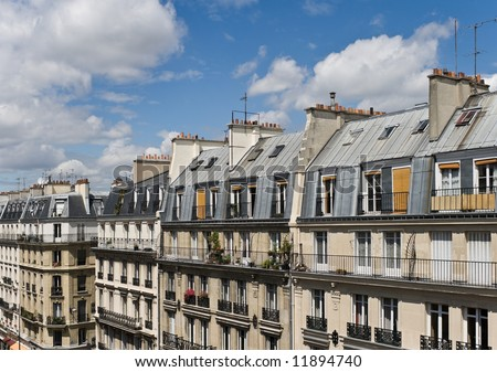 View of upper floors and rooftops of street and apartments in Paris in the Latin Quarter - stock photo