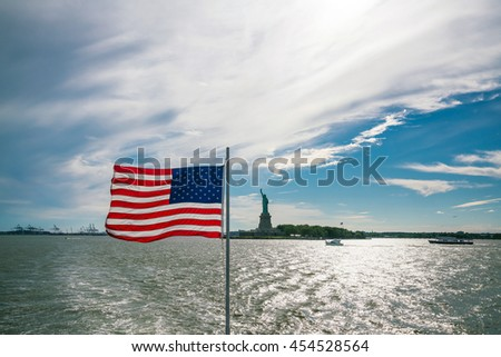 View of USA flag with Statue of Liberty from Hudson River