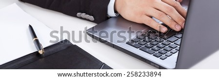 View of using computer in the office - stock photo