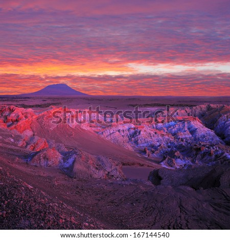 view of Valle de la Muerte (Death Valley) at sunset, Atacama desert, Chile. - stock photo