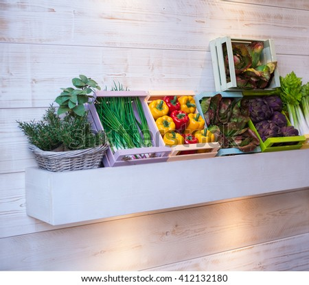 View of variuos vegetables inside the wooden boxes - stock photo