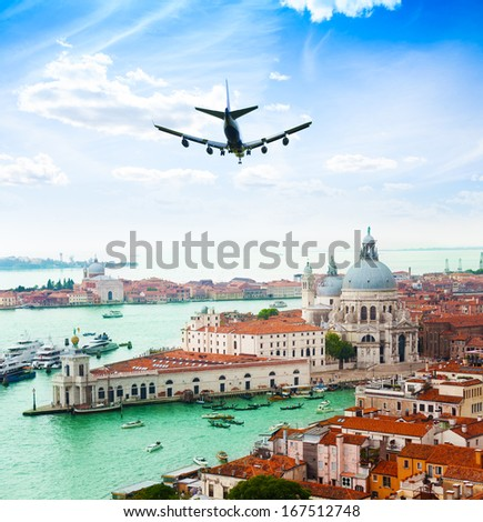 View of Venice and Grand Canal in Santa Maria della Salute Basilica and flying over plane - stock photo