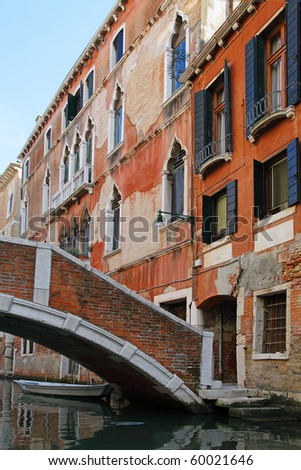 View of Venice with bridge with canal and old buildings, Italy - stock photo