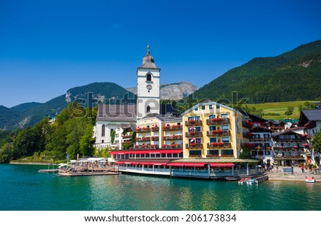 View of View of St. Wolfgang chapel and the village waterfront at Wolfgangsee lake, Austria - stock photo