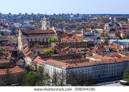 View of Vilnius city in Lithuania, with historical architectural structures, buildings around, on blue clear sky background. - stock photo