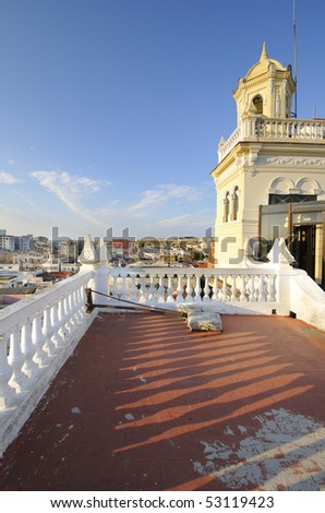 View of vintage building terrace and cityscape of Old Havana in the background - stock photo