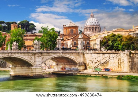 View of Vittorio Emanuele bridge on the Tiber river and St. Peter's Basilica in Vatican