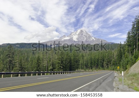 View of volcanic Mt. Hood, highest mountain in Oregon (11,249 feet, or 3,429 meters) and training ground for winter athletes, from Mount Hood Highway No. 26 in September - stock photo