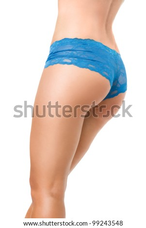 View of voluptuous female buttocks in blue panties - stock photo