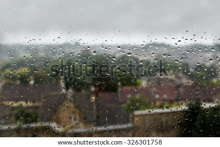 View of Water Drops on a Window during a Rainy Day - stock photo