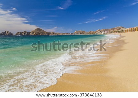 View of Waves at Sandy Beach of Cabo San Lucas in Mexico - stock photo