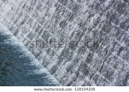 View of weir with rapids - stock photo