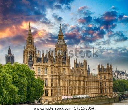 View of Westminster Palace at sunset from the other side of Thames. - stock photo