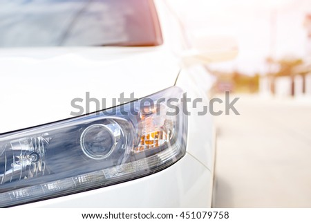 view of white car headlights close up