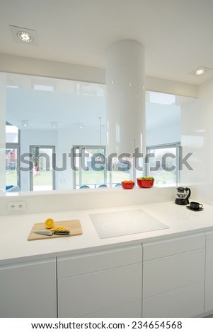 View of white furniture in contemporary kitchen - stock photo