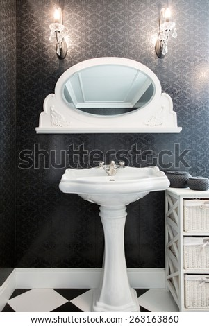 View of white sink in vintage bathroom - stock photo