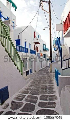 View of Whitewashed Buildings in Alleyway in Mykonos - stock photo