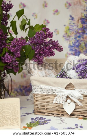 View of wicker basket and flowers on the table