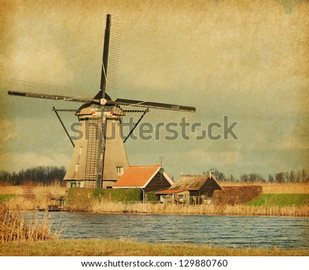 View of windmill at Kinderdijk, Netherlands. Photo in retro style. Paper texture. - stock photo