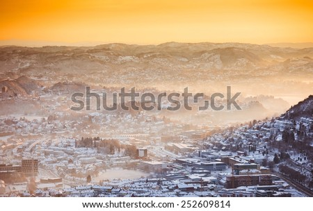view of winter city with fog  from the mountain top - stock photo
