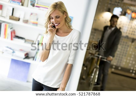 View of woman on the phone in the office